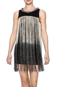 Sleeveless black tunic with a chunky braided metal neck and ombre lurex fringe all over.    Ombre Fringe Tunic by Frank Lyman. Clothing - Dresses - Printed New Jersey Atlantic City, New Jersey