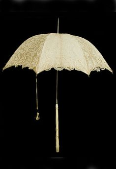 Brussels lace parasol with ivory handle, 1860s