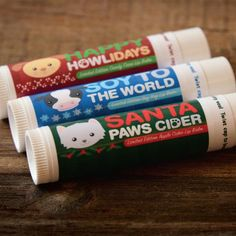 """Let your lips celebrate this season with #vegan lip balms. They come in 3 lip-smacking flavors: """"Soy To the World"""" Soy Nog, """"Happy Howlidays"""" Candy Cane, """"Santa Paws Cider"""" Apple Cider. If you're looking for the perfect stocking stuffer for the vegan in your life, look no further! <3  Ingredients: Sunflower Oil, Candelilla Wax, Cocoa butter, Sweet Almond Oil, Castor Oil, Jojoba Oil, Avocado Oil, Aloe Vera, Essential and/or Flavor Oil."""