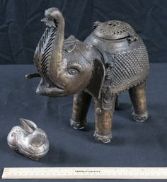 Metal Handcrafted Intricate Metal Elephant Box with Head and Back Openings  For more information visit us @ www.CalAuctions.com