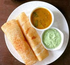 A crispy thin South Indian spicy dish made with rice and lentil batter has made its position in India. Masala Dosa consists of spicy potato and fragrant stuffing, called masala. Masala Dosa can be best enjoyed when served with coconut white chutney and delicious sambar. #masaladosa #dosa #sambardosa Indian Food Recipes, New Recipes, Vegetarian Recipes, Ethnic Recipes, Masala Dosa Recipe, Chaat Masala, Plain Dosa, Spicy Dishes, Lentil Curry