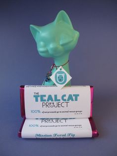 The Teal Cat Project/Rescue Chocolate Mission Feral Fig Bar. Fig Bars, Project 100, Animal Projects, Animal Rights, Vegan Chocolate, Teal, Christmas Ornaments, Holiday Decor, Cats