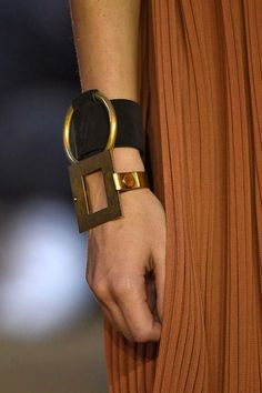 Céline leather cuff with a gold hoop and large metallic square