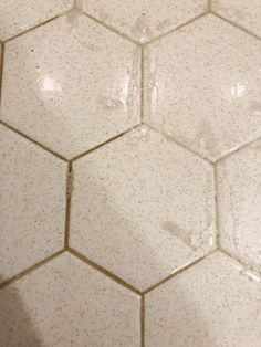 Before you rip out your ugly bathroom tile, you should read this! We changed our bathroom tile for $150 bucks and it looks amazing! Tub And Tile Paint, Painting Bathroom Walls, White Bathroom Tiles, Bathroom Floor Tiles, Tile Painting, Floor Grout, Bath Paint, Wall Tile, Bathroom Design Luxury