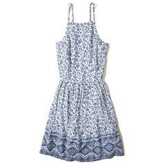 Hollister Lace-Up Woven Skater Dress (532.335 IDR) ❤ liked on Polyvore featuring dresses, white pattern, high neck dress, open back skater dress, white open back dress, white dresses and white fit-and-flare dresses