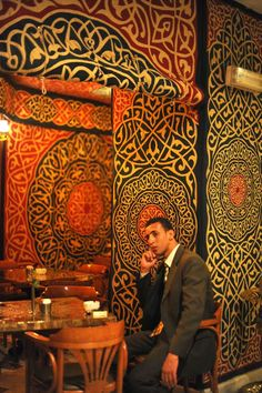 Interior of Naguib Mahfouz restaurant in the Khan el-Khalili, Cairo - photo by Maryam Montague. The dramatic background panels are genuine hand-stitched Khayamiya panels from the Street of the Tentmakers.