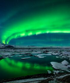 Spectacular auroral display over the glacier lagoon Jokulsarlon in Iceland | TOP 10 Things to See and Do in Iceland