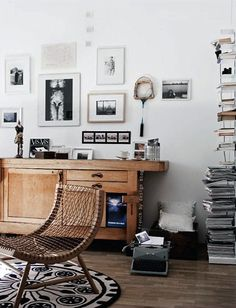 Piles of papers + typewriter + MAJOR chair = my apartment (if I had a typewriter and a MAJOR chair).