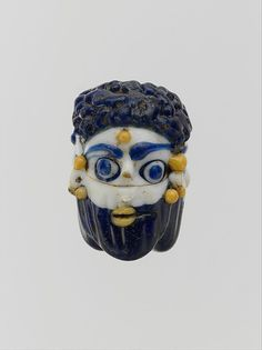 Glass face with beard - Phoenician or Carthaginian, Late classical period, mid 4th - 3rd century BC. Metropolitan Museum