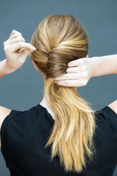 <p>Twist the ponytail into a chignon, and use your other hand to pin with several bobby pins (place one every half inch).</p>