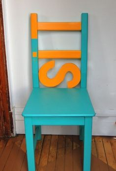 how cute is this! old wooden chair, primer and paint, plus one wooden letter .. chair art!