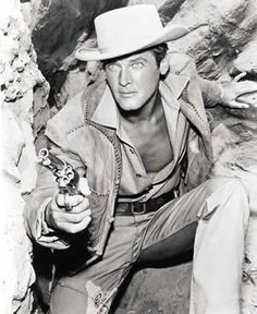 Roger Moore looking very hot - never seen him as a cowboy before
