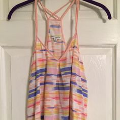 Strapped tank Multi-colored strappy tank. Crosses over in the back. Sides are longer than middle. Thin material, perfect for warm weather. New without tags, never worn. American Eagle Outfitters Tops