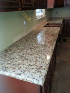 Giallo Napoli granite kitchen countertop install for the Belue family. Knoxville's Stone Interiors. Showroom located at 3900 Middlebrook Pike, Knoxville, TN. www.knoxstoneinteriors.com. Estimates available, call 865-971-5800.