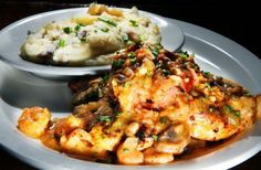 Topped with crawfish sauce and smoked sausage, the Bourbon Street Chicken at Buckley's is like eating gumbo with a knife and fork. (Justin A. Shaw, Special to The Commercial Appeal)