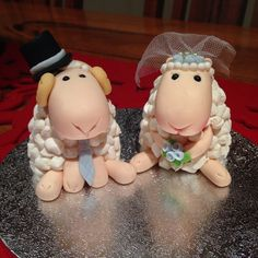 Bride and groom sheep cake toppers