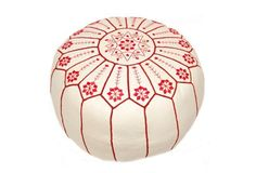 Gorgeous red embroidery on this white leather pouf.