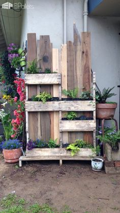 "#Garden, #Outdoors, #PalletPlanter, #RecyclingWoodPallets Shady plants deserve their time in the ""sun"" too! I wanted a way to feature some of my shade-loving plants, and came up with this Pallet Vertical Shade Garden! All the materials were lying around our property. This easy and decorative Ornamental"