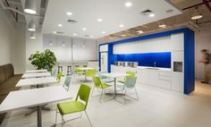 Sleek furniture and bold colors provide an inspiring atmosphere for associates and visitors to mingle.