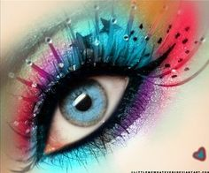 Stunning prismatic eye shadow with crystal accented statement eye lashes.
