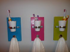 Individual towel/cup/toothbrush holders. Awesome bathroom organization idea!