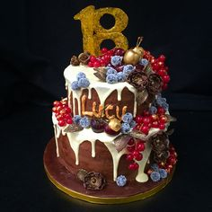 Winter berry chocolate cake with modelling chocolate flowers and leaves. Gold detail. 18th birthday cake
