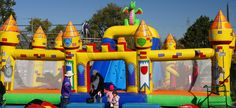 Three different jumpy castles set up for children of all ages.