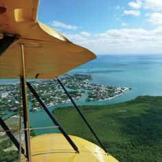 106 Days of Summer, Day 99: Soar over your coastline with a helicopter or plane tour of the area. Visiting the Florida Keys? Overseas Aero Tours (pictured) will get your head in the clouds and your sights set on the neon blue sea, 300-pound sea turtles, and friendly manatees from above. - Coastal Living