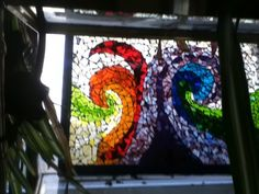 """""""Light waves""""  Glass-on-glass mosaic. This one is a play on words since we can see light in only a certain wave-length, that is, the rainbow colors seen here. By Deb Olander debolander@gmail.com"""