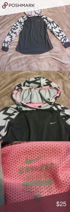 Nike women dri-fit hoodie black and grey Nike women's dri fit hoodie black, Grey and pink accent.   Gently used. No flaws. Nike Jackets & Coats