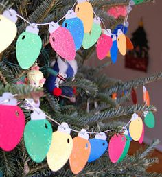 Kid Christmas craft: string of lights.  Scrapbook paper, glazes, glitter, cord, imagination.