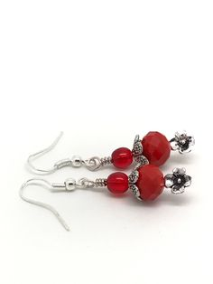 A personal favorite from my Etsy shop https://www.etsy.com/listing/535537366/red-and-silver-coral-earrings-red