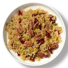 Cranberry-Pecan Quinoa Pilaf Ingredients:  1 cup quinoa 2 cups water 1 tablespoon olive oil 1/2 cup thinly sliced scallions, white and green parts 1/2 cup dried cranberries 1 tablespoon chopped flat-leaf parsley 1 teaspoon lemon zest Juice of 1 lemon 2 teaspoons honey Salt Freshly ground black pepper 1/2 cup pecan halves, toasted.  :     http://www.fitnessmagazine.com/recipes/quick-recipes/dinner/one-recipe-two-meals/?page=3