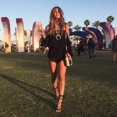 Rocky Barnes in black romper with turquoise and silver squash blossom necklace and black lace up sandals
