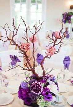 Purple flower and branch centerpiece.