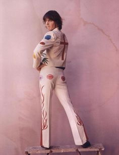Ah yes, the infamous Nudie suit from burrito brothers album cover.  The group was upset Gram spent so much of their money on swag, but they are remembered to this day, and the album cover is an inspiration to many bands. Gram's suit is an homage to illicit drugs with the addition of one sweet red cross on the back.