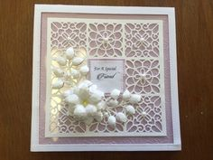 card created with inspiration from Johnathon Lockwood. Using the quilted blocks striplet die, star swirls embossing folder and foundation lilac card
