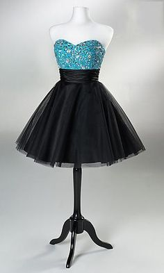 A strapless dress with a black puffy skirt separated from the sparkly sky blue bra like tank would look great on somebody tan.