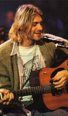 Kurt Cobain - mtv unplugged  i have this exact picture framed in my room with a candle next to it