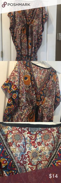 Boho dress One size. Adorable boho dress ties around the waist. Perfect with leggings and booties. Dresses