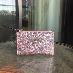 Kate Spade Glitter Cori Has been used. Clean. In great condition. Has a keychain and a back pocket. ❌No trades!❌ kate spade Bags Wallets