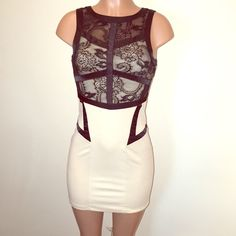 LF nude & black lace dress LF brand; TFNC LONDON• size small (fits a 4-6 best)• nude color cotton with black accent lines & black lace top half• stretchy, and has covered zipper on the backside (see last photo as parts of the zipper are showing more black fabric when stretched, it's an easy fix for a seamstress if it bothers you! It didn't bother me, so I just wore it just like that...as purchased! Super sexy dress, chic yet comfortable! Buy it here for a fraction of LF retail prices!! You…