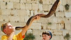 children blowing shofar at Western Wall in Israel