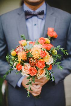 Orange and peach bridal bouquet with succulents // Desmond and Lay Peng's Rustic Garden Wedding at Singapore Botanic Gardens #citrus #shades