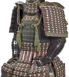 An unusual green-lacquer armor with a nuinobe do, Edo period, 19th century, component parts lacquered green and laced in purple and white in alternating stripes with green highlights, the cuirass a nuinobe do with the top and lower sections laced in kebiki style, and applied with two gilt-metal tenugui no kan, the cuirass fitted with seven sections of five-lame kusazuri, the lowest lame lacquered with gold matsukawabishi crests; chusode mounted with gilt-metal hardware; tsutsugote.