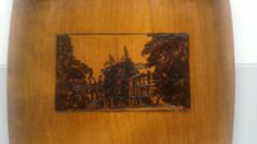 A design of Jordanhill College on a wooden tray.