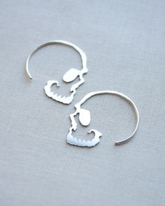 Our silver skull hoop earrings are the perfect accessory with a little edge. These are handmade with love in sterling silver and measure 1 inch by 1 inch. Such a unique take on skull earrings! Order b More