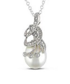 AKOYA PEARL dangles gracefully onthis beautiful pendant. laced with diamonds