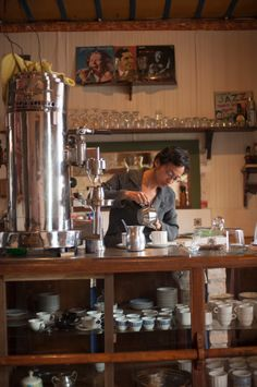 View top-quality stock photos of A Woman Working In A Traditional Coffee Shop In Salento A Coffee Producing Region Of Colombia. Find premium, high-resolution stock photography at Getty Images. Coffee Shop, Liquor Cabinet, Countertops, Stock Photos, Traditional, Bella, Houses, Shopping, Woman