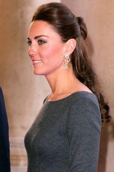 Kate Middleton wears a half-bun with an elegant, royal twist.